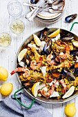 Paella with seafood, chicken and lemons