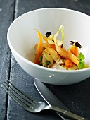Scallops soup with carrots, sea buckthorn and lemon balm
