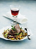 Lamb with diced potatoes, tender wheat and thyme