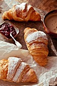 Butter croissants with raspberry jam and a cappuccino