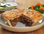 Steak and onion pie, sliced