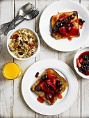 Spicy berries toast, muesli and orange juice for breakfast