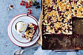 Redcurrant cake on a baking tray and on a plate