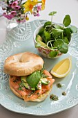 A bagel with smoked salmon and avocado for a spring brunch