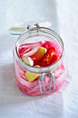 Pickled red onions with garlic and chilli peppers