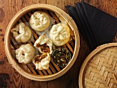 Steamed dumplings with pulled pork (Asia)