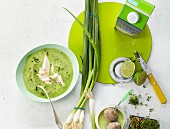 Potato and herb soup with trout fillet and lime juice