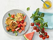 Rice fritters with a tomato and melon salad