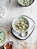 Dovga (yoghurt and herb soup from Azerbaijan) with chilli flakes