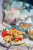 Earl Grey scones with raisins, clotted cream and strawberry jam