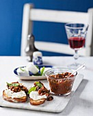 Anchoiade with anchovies and dried tomatoes on slices of grilled bread with goat's cheese