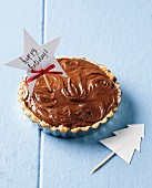 Chocolate and coconut tart as a gift