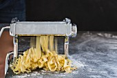 Homemade fresh tagliatelle with a pasta machine