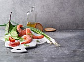 An arrangement of prawns and salad ingredients