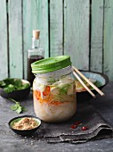 Miso soup with tofu and sesame seeds in a jar