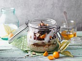 Porridge with grapes and physalis in a jar