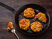 Sheep's cheese fritters with oats and red peppers