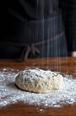 Bread dough being sprinkled with flour