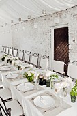 White wedding dinner table set in rustic style