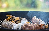 Langoustine tails on a barbecue