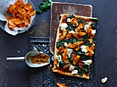 Pizza with spinach, turnip crisps and ricotta