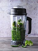 Green smoothie ingredients in a blender