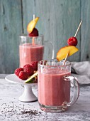 Fig and raspberry smoothies with pineapple, peaches and chia seeds