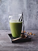 A mulberry and pineapple smoothie with barley grass powder and vanilla