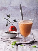 A tomato and pepper smoothie with red seaweed and sunflower seeds