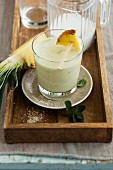 A pineapple and coconut smoothie with mint