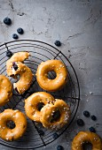 Blueberry and ricotta doughnuts with salted caramel and chocolate glaze