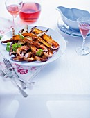 Spiced, roasted butternut squash slices with sweet potato wedges