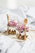 Muesli with yoghurt and raspberries in jars