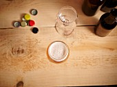 Beer glasses, beer bottle caps and beer bottles on a wooden surface