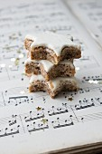 Three cinnamon stars on a piece of sheet music