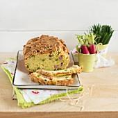 Savoury cake with Comté cheese, peas and ham