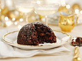 Christmas pudding, sliced (Great Britain)