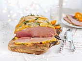 Glazed roast ham with oranges for Christmas