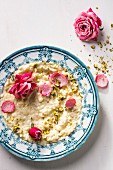 Rice pudding with pistachio nuts and roses