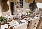 Elegant African decorations on table set for Christmas dinner