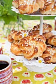 Almond pastries with sugar nibs on a cake stand