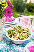 Pasta salad with radishes, rocket and lemon zest