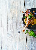 Spicy goose legs with crispy skin and borage flowers (Paleo)