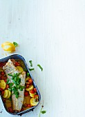 Oven-baked cod on a bed of vegetables