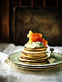 A stack of potato pancakes with herb crème fraîche and smoked salmon