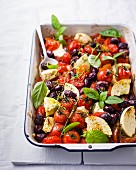 Oven-baked tomatoes and olives with feta cheese