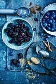 Blackberries, blueberries, nutmeg, cinnamon sticks and sugar