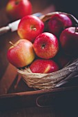 Red apples in a paper bag