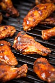 Glazed chicken wings on a grill
