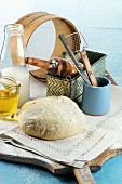 An arrangement of baking utensils, bread ingredients and bread dough